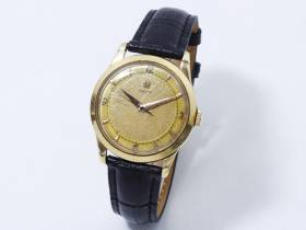 Omega, montre d'homme en or